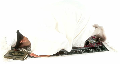 a person is performing sajdah.
