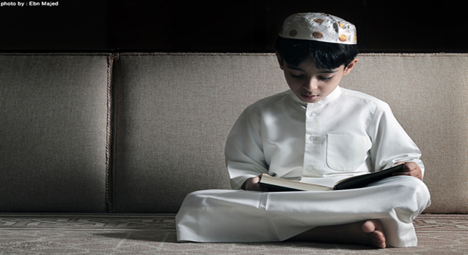 A boy is reciting the Qur'an.
