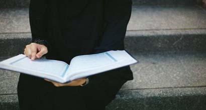A Muslim woman reads the Qur'an.