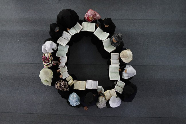 A group of Muslim women are studying the Qur'an.