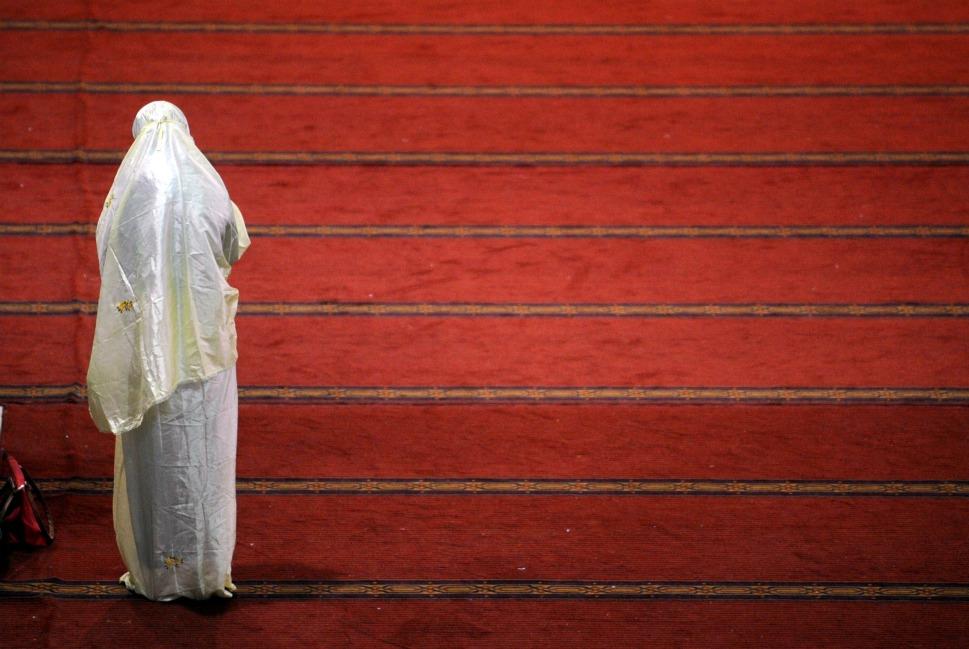 A women offer prayer at the mosque.