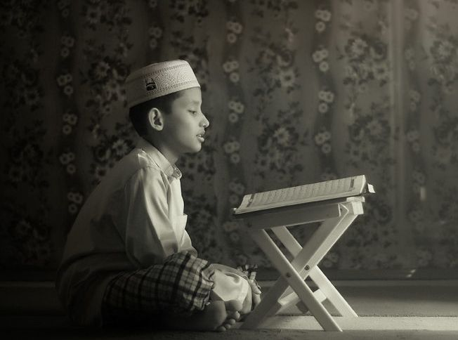 A boy recites the Qur'an
