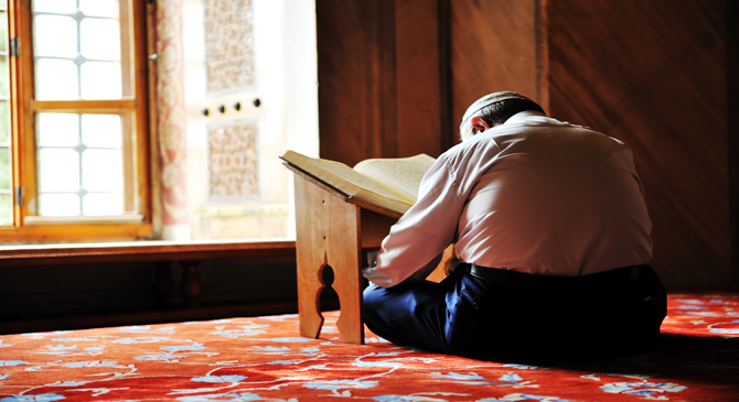A person is reading the Qur'an.