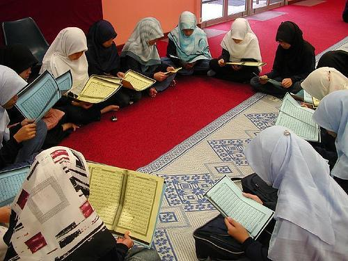 a group of little girls recite the Qur'an.