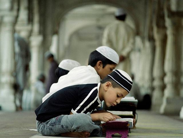 Some kids recite the Qur'an.