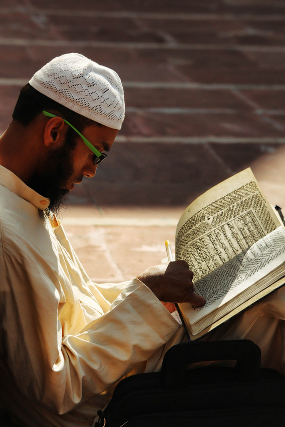 A man recites the Qur'an - The Qur'an Elevates Some and Degrades Others